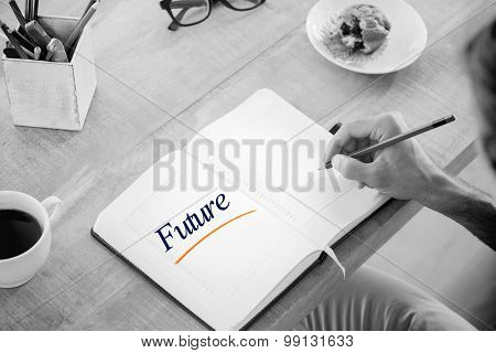 The word future against man writing notes on diary