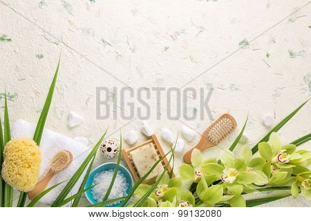 Spa still life with towel,brush,salt and orchid
