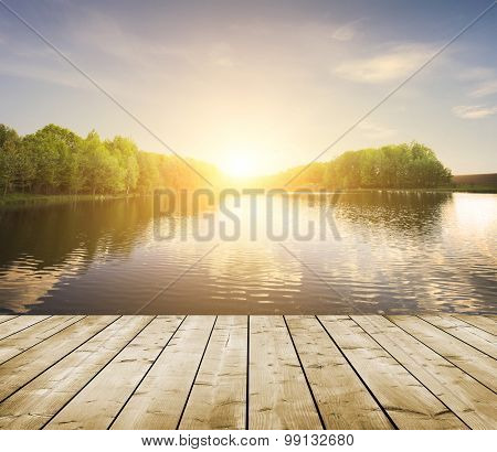 forest lake and wooden board background