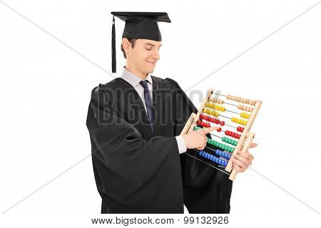 Young college graduate in a black graduation gown counting on an abacus isolated on white background