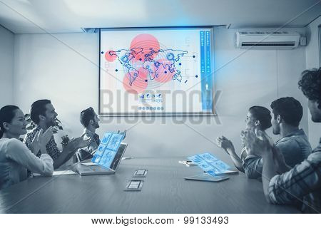 Global business interface against attentive business team applausing after a conference