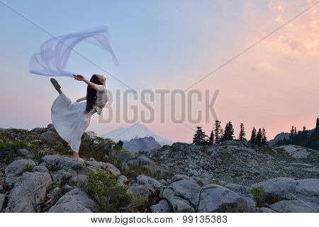 A Girl Dancing At Sunset On Artist Point, Mt. Baker, Washington