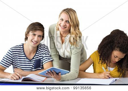 Teacher helping student in class against white background with vignette