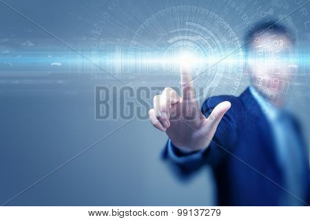 Close up of businessman touching virtual panel with finger