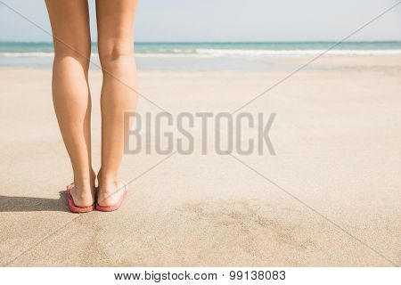 Woman standing on the sand at the beach