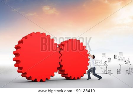 Businessman bending and pushing against blue sky