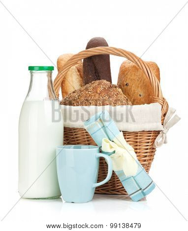 Picnic basket with bread and milk bottle. Isolated on white background