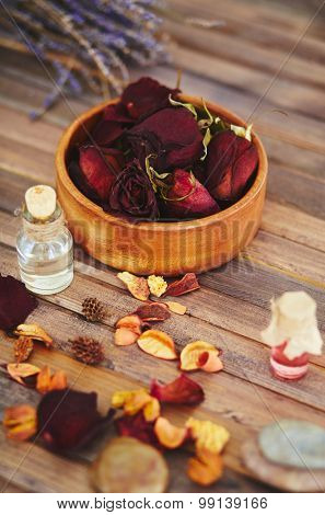 Close-up of dry rose petals and essence