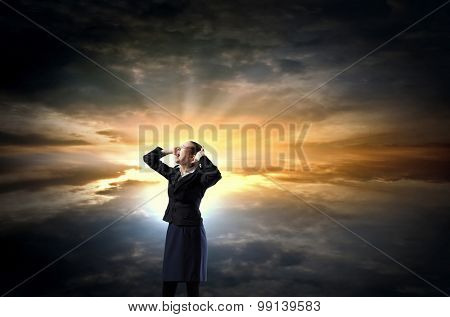 Young frustrated businesswoman covering ears with hands and screaming loud