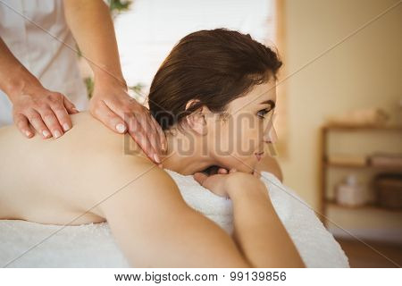 Young woman getting a massage in therapy room