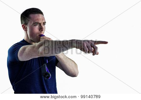 Profile view of an attentive trainer blowing his whistle