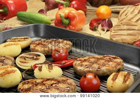 Homemade Pan-fried Burgers In Grill-pan On Rustic Dinning Table. Still-life
