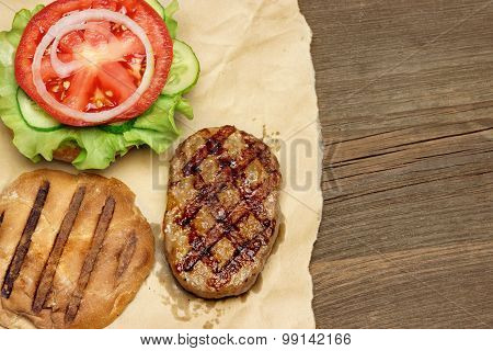 Close-up Top View Of Grilled Hamburger On Brown Paper