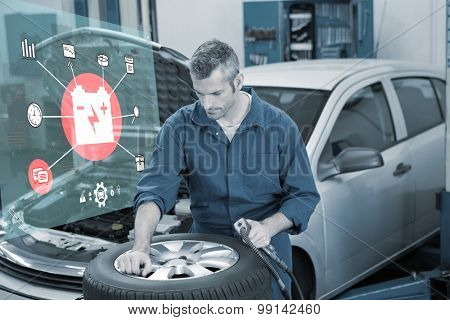 Engineering interface against focused mechanic inflating the tire