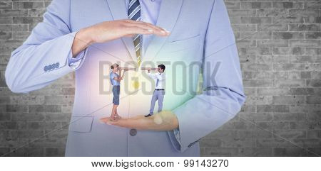 Business people looking at each other against grey room