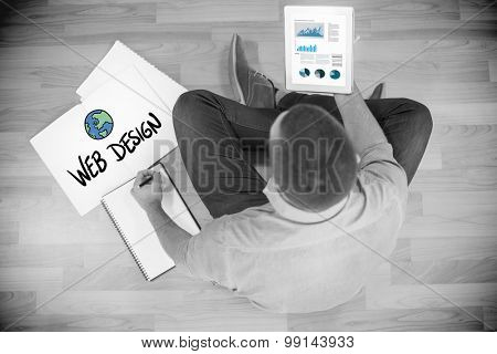 Business graphs against young creative businessman looking at tablet