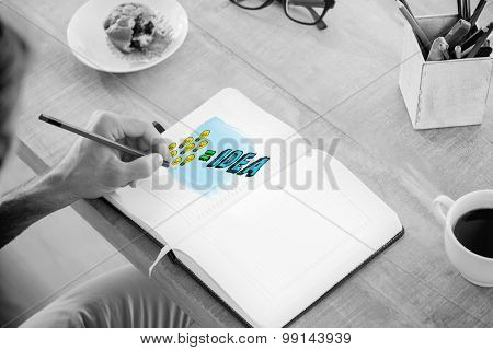 Man writing notes on diary against idea equation