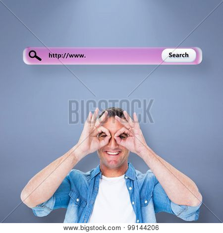 Smiling man with fingers around his eyes against purple vignette