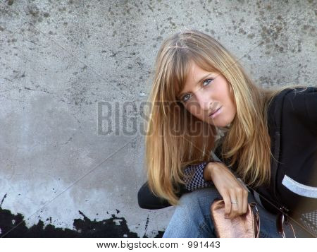 Girl Against Grunge Wall