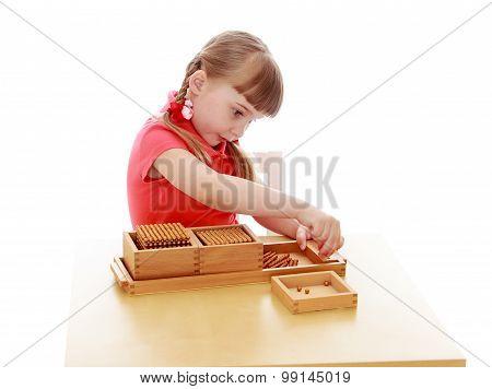 Little girl in a Montessori environment
