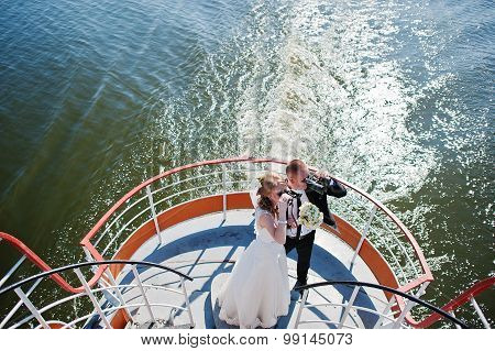 Wedding Couple On Ship Looking Through Binoculars