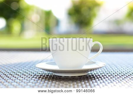 Coffee Cup On Blurred Green Nature Background - Chill Out Concept
