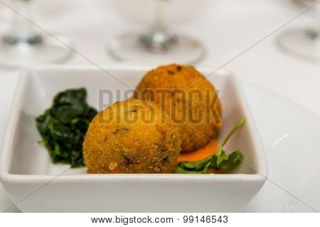 Conch Fritters With Spinach