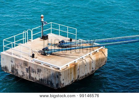 Concrete Mooring Platform With Blue Ropes