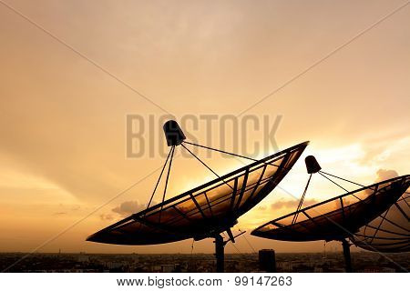 Satellite Dish Silhouette On Twilight Sky Background