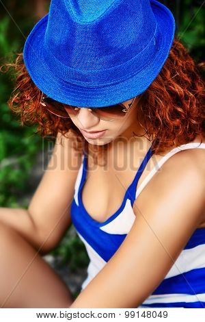 Elegant young woman with beautiful curly hair outdoors. Beauty, fashion.
