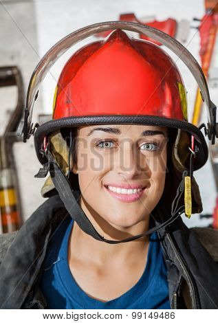 Closeup portrait of happy firewoman at fire station
