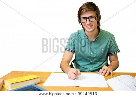 Student sitting in library writing against white background with vignette