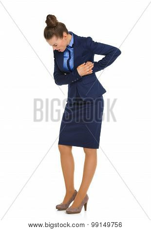 Businesswoman In Pain Holding Side And Looking Down