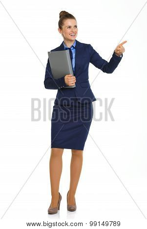 Smiling Businesswoman Holding File And Pointing Into Distance
