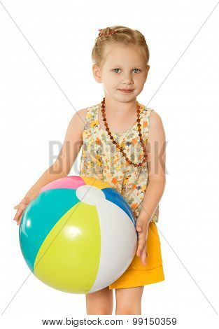 Girl on beach with ball