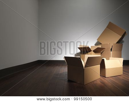 Moving House Boxes Empty Room - Stock Image