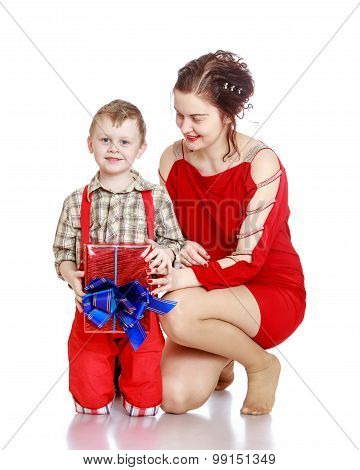 Mom gives a gift to his son