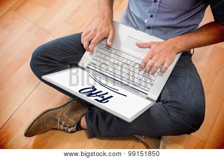 The word faq against young creative businessman working on laptop