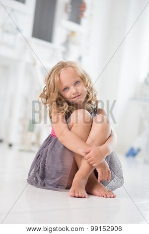Female child sitting on the floor