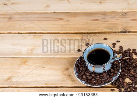 Coffee cup on the wooden table