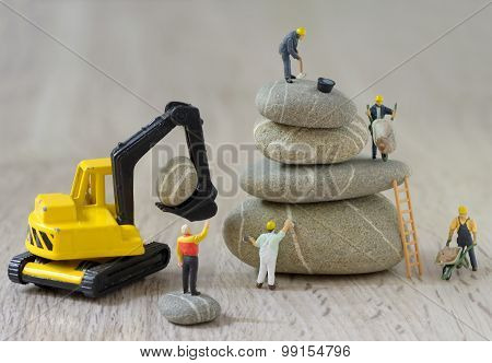 Pebbles Stack And Figurines Workers