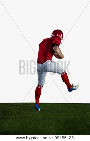 American football player playing football on american football field