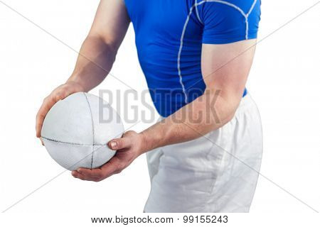 Rugby player about to throw the rugby ball on a white background