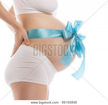 pregnant caucasian woman closeup body isolated on white background studio shot belly side view blue