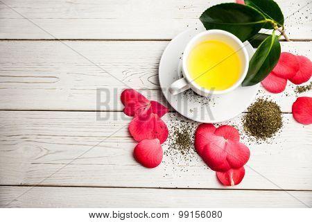Cup of herbal tea on table shot in studio