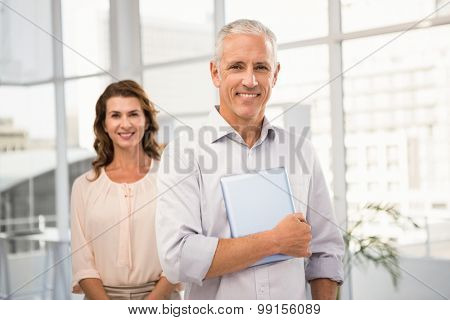 Portrait of casual business colleagues smiling at camera in the office