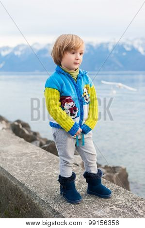 Winter portrait of a cute little boy