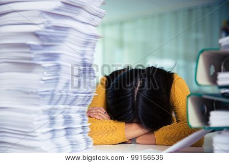 Portrait of a casual businesswoman sleeping at the table in office
