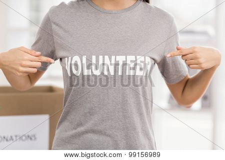 Female volunteer showing her shirt in the office