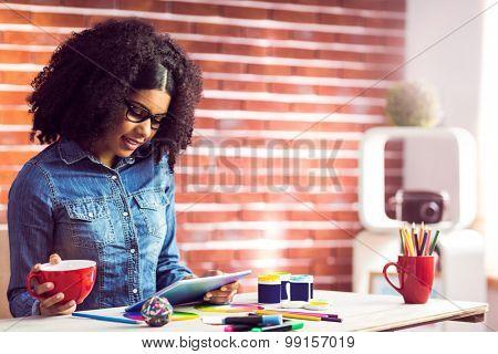 Casual businesswoman on a coffee break in her office